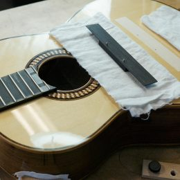 fitting guitar bridge